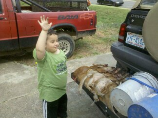 WeHuntSC.com - Marcus holding up his hands signaling how many hogs they had