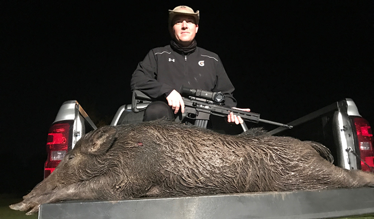 Garth Knight with Hog