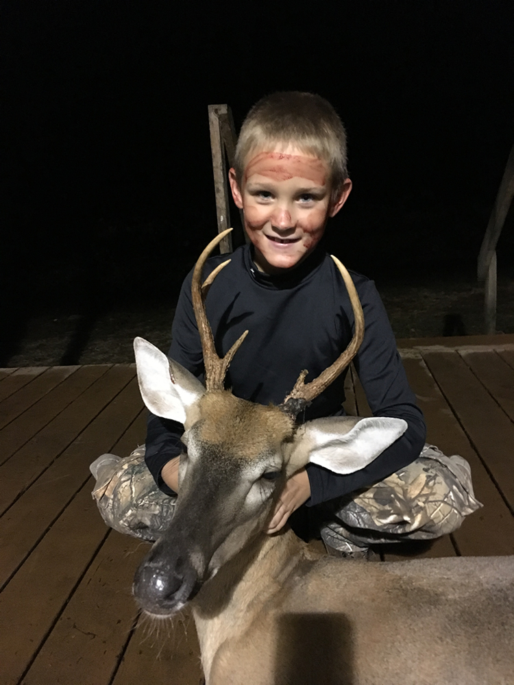 Bryson with his first buck