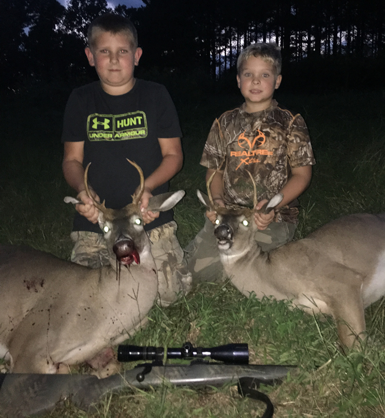 Kingston and Caiden with bucks